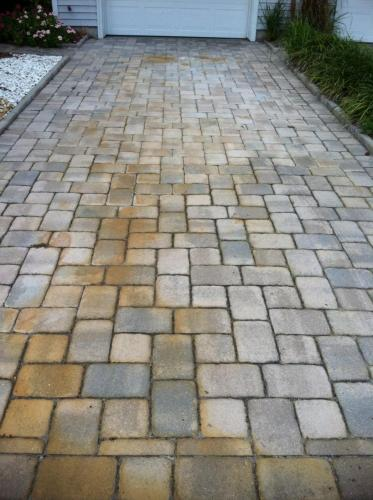 Battery Acid Stains on Pavers Before