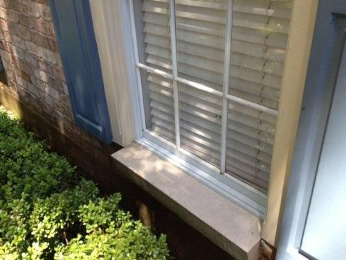 Rust Removal on Siding and Shutters After