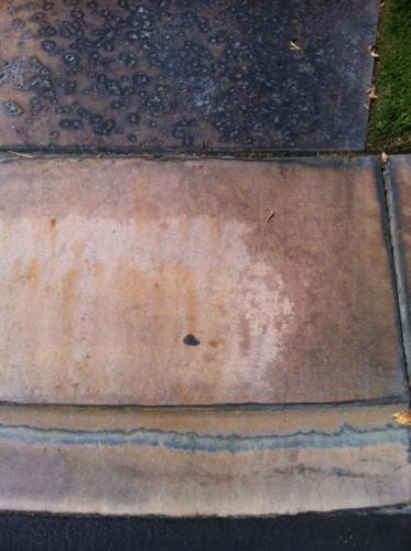 Battery Acid Stains on Colored Concrete Before